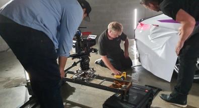 cameramen recording a car getting wrapped close up