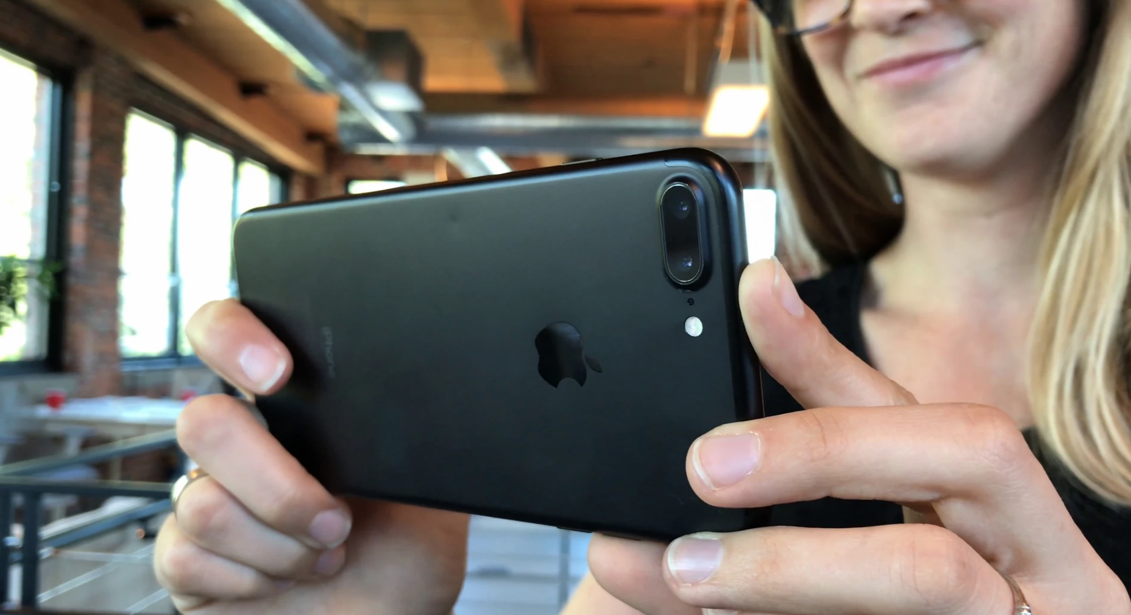 picture of black iphone being held by a woman