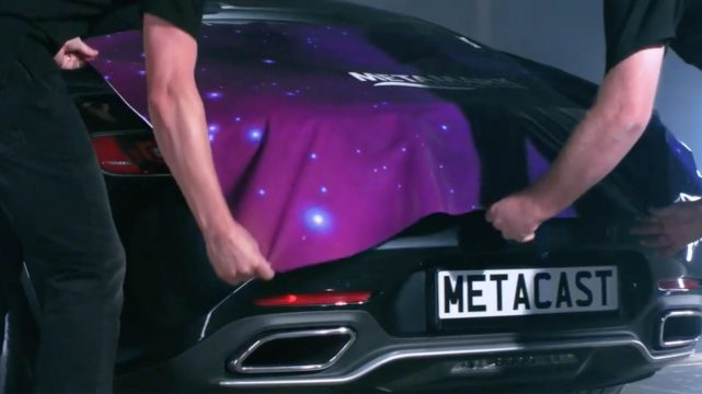 rear of a sportscar covered by purple cloth